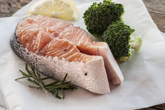Salmon raw. salmon red fish steak with herbs Stock Photos