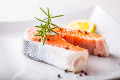 Salmon. Raw salmon steak with rosemary lemon salt and pepper Stock Photography