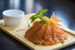 Salmon raw sashimi on wooden plate Stock Photography