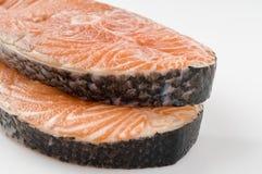 Salmon raw steak on white Royalty Free Stock Photography