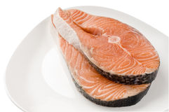 Salmon raw steak on white plate Stock Images