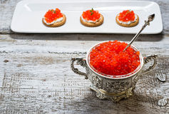 Salmon red caviar in silver bowl Stock Images