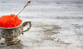Salmon red caviar in silver bowl Royalty Free Stock Photo