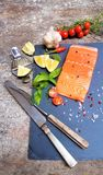 Salmon of red color. Salted salmon fillet with spices. Raw salmon filet on dark slate background, wild atlantic fish. Fresh fish. Salmon fillet on black stock photo