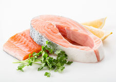 Salmon red fish steak. Salmon raw. salmon red fish steak with herbs and lemon  on a white background Stock Photo