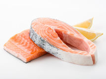 Salmon red fish steak. Salmon raw. salmon red fish steak with herbs and lemon  on a white background Stock Images