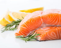Salmon red fish steak. Salmon raw. salmon red fish steak with herbs and lemon  on a white background Royalty Free Stock Photography