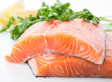 Salmon red fish steak. Salmon raw. salmon red fish steak with herbs and lemon  on a white background Royalty Free Stock Images