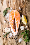 Salmon red fish steak. Salmon raw. salmon red fish steak with herbs and lemon  on a white background Royalty Free Stock Photo