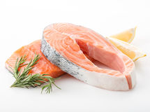 Salmon red fish steak. Salmon raw. salmon red fish steak with herbs and lemon  on a white background Royalty Free Stock Photos