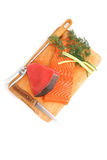Salmon and red tuna fish pieces over wood Stock Image