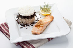 Salmon and rice tart garnished with dill,lemon slice Royalty Free Stock Photography