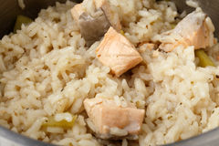 Salmon risotto cooking. In a saucepan Royalty Free Stock Photo