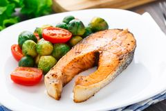 Salmon with roasted brussels sprout and tomato Stock Image