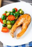 Salmon with roasted brussels sprout and tomato Royalty Free Stock Images