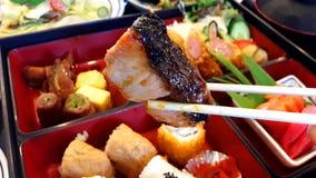 Salmon roasted soy sauce Sushi food. Salmon roasted soy sauce, sushi food, Japanese food on a wooden chopsticks ready to eat Royalty Free Stock Image