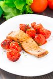 Salmon with roasted tomatoes Royalty Free Stock Photos