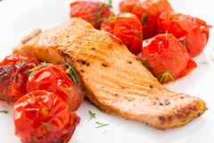 Salmon with roasted tomatoes Stock Photography