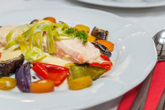 Salmon with roasted vegetables stock photography