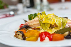 Salmon with roasted vegetables stock images