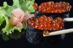 Salmon roe. Ikura sushi , ikura with seaweed (Nori), japanese cuisine,Salmon roe Royalty Free Stock Images