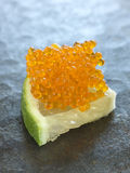 Salmon roe on a slice of lime Stock Photos