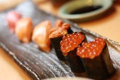 Salmon roe sushi. Ikura, salmon roe, sushi highlighted among others Stock Image