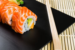 Salmon Roll. Delicious salmon roll sushi on dish Stock Image