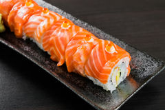 Salmon roll on the table. Six salmon roll sushi for restaurant menu Royalty Free Stock Photography