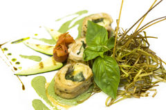 Salmon rolls. Cooked salmon rolls with cheese and basil Stock Images