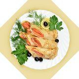 Salmon rolls in crepes with greens. Royalty Free Stock Photos