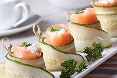 Salmon rolls with cucumber, cream cheese and herbs Royalty Free Stock Photos