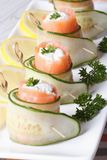 Salmon rolls with cucumber, cream cheese macro vertical Royalty Free Stock Photography