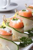 Salmon rolls with cucumber, cream cheese vertical Stock Photos