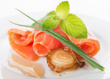 Salmon rolls with greens and fried onion Stock Images