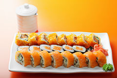 Salmon rolls and saucer Royalty Free Stock Photography