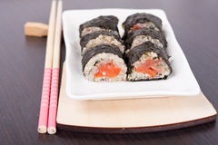 Salmon rolls. Served on a plate Stock Photos