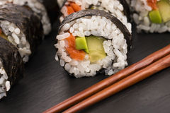 Salmon rolls served on a plate Stock Photography
