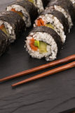 Salmon rolls served on a plate Royalty Free Stock Images