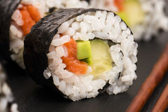 Salmon rolls served on a plate Royalty Free Stock Image