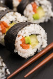 Salmon rolls served on a plate Stock Photos
