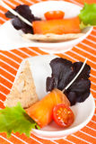 Salmon rolls stuffed with cheese. And decorated con tomatoes Stock Photography