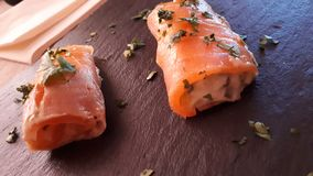Salmon rolls with tartar sauce stock image