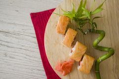 Salmon rolls on wooden background Stock Image