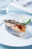 Salmon with rosemary and lime slice Royalty Free Stock Photos