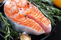 Salmon with rosemary in pan Stock Images