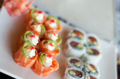 Salmon roses. An assortment of freshly made sushi on a plate stock image