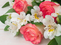 Salmon roses and white alstroemeria Stock Images