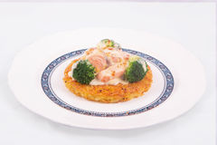 Salmon Rosti served with boiled broccoli and white bechamel sauce Royalty Free Stock Photo