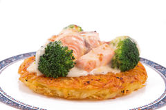 Salmon Rosti served with boiled broccoli and white bechamel sauce Royalty Free Stock Photography